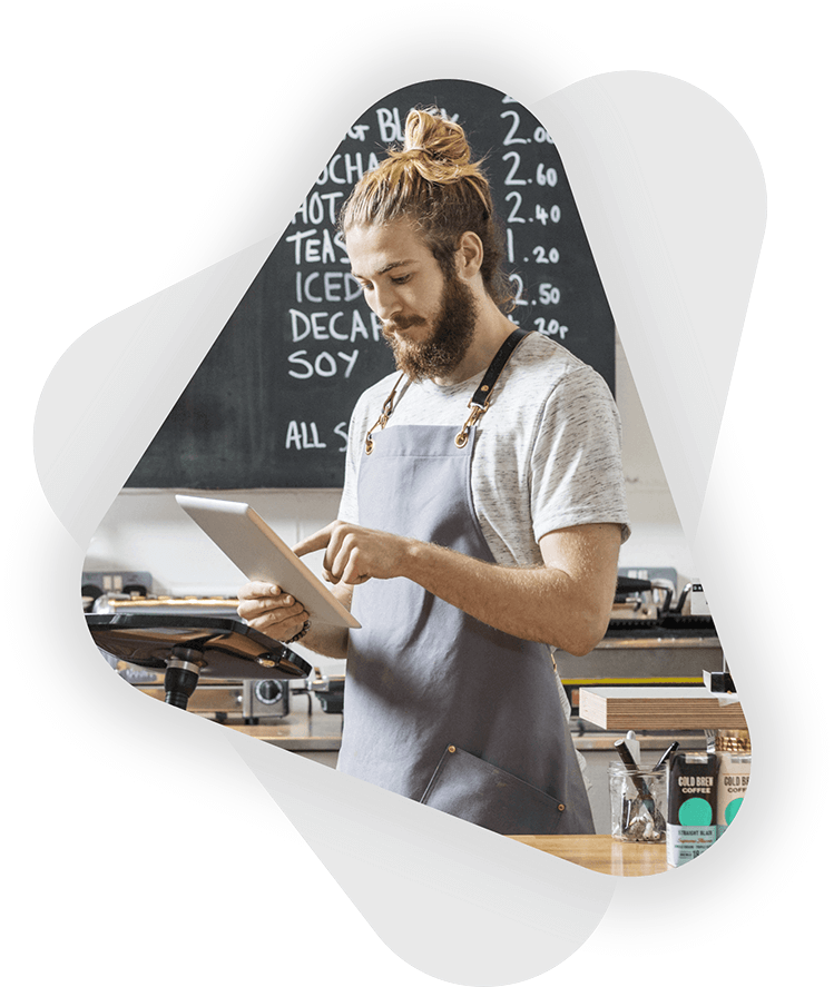 male cafe business owner working on tablet